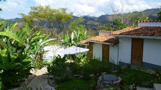Terramaya: Hotel garden and view