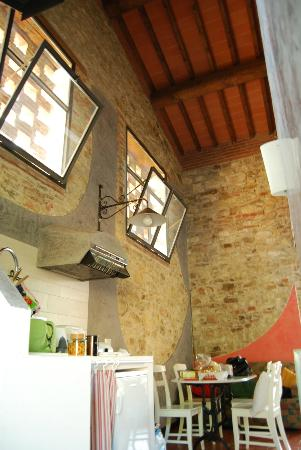 Agriturismo Verde Oliva: dining and living area in large barn