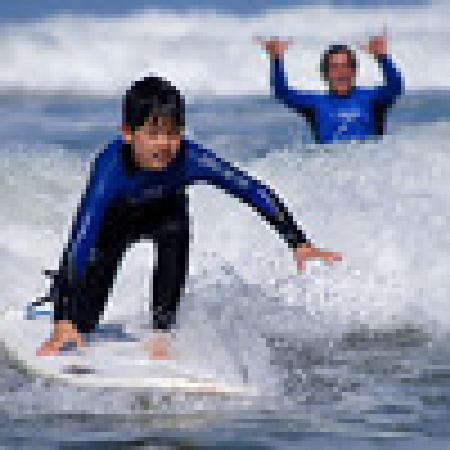 Surfin Fire  Premiere Surf lessons: Surf lesson at Moonlight beach
