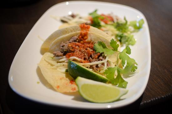 AGAVA Restaurant : Pork carnitas in our house-made soft tacos