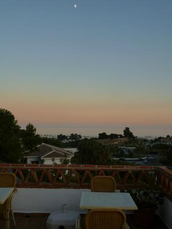 Rural Hotel Almazara: Sunset over Nerja and Mediterranean - A view from the terrace.