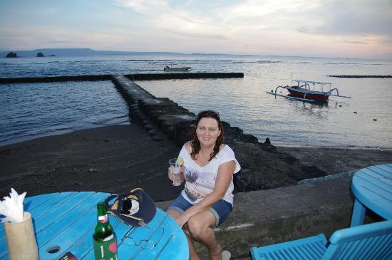 Puri Oka Beach Bungalows: Enjoying a drink out front.