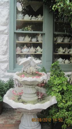 The Garden Gate Tea Room: front out door area tea pots inside window