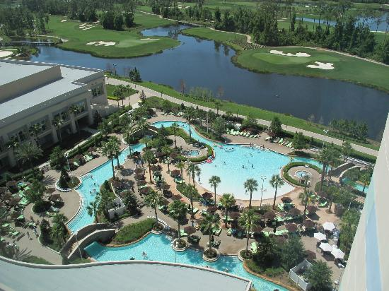 piscina con playa y lazy river picture of hilton. Black Bedroom Furniture Sets. Home Design Ideas