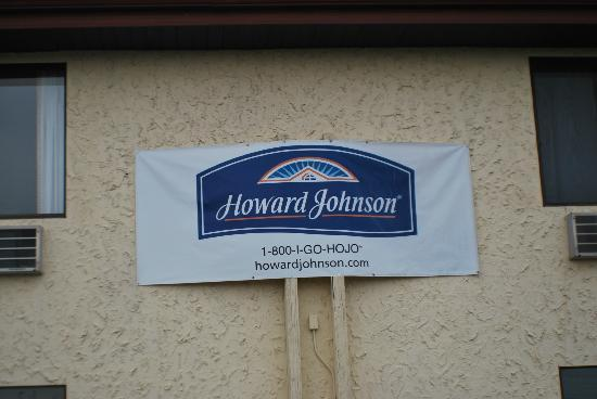Howard Johnson Inn Appleton: over hang metal  next to car. Appleton.