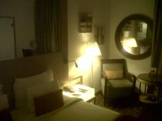 Pride Hotel Chennai: one easy chair with a round table