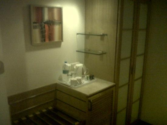 Pride Hotel Chennai: Mini bar and cupboard