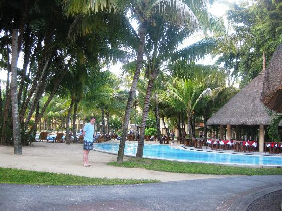 Canonnier Beachcomber Golf Resort & Spa: The pool area.. taken from the bar... of course... it was pina colada o'clock!!