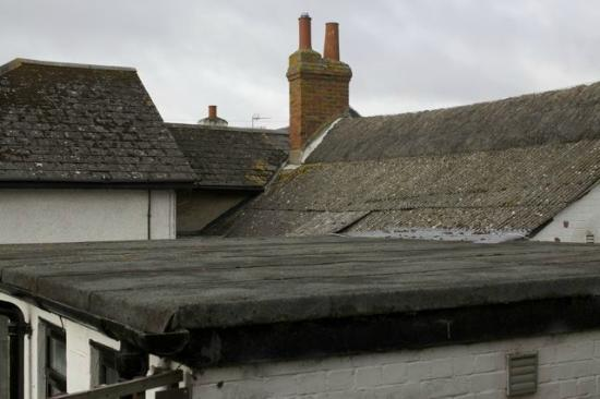 The London Guesthouse: Note patched up roof.  Cold, damp accommodation.