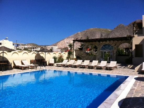 Thera Mare Hotel: The pool area as seen looking toward the land with the mountains in the background.