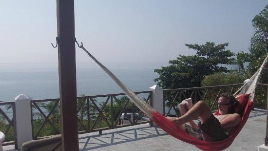 BlueBelize: My husband relaxing on the veranda...