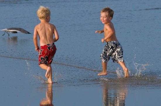 Port Aransas, TX: Kids running and playing on the beach in Port A