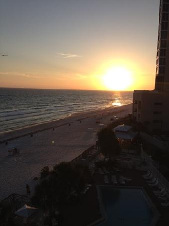 Palmetto Inn & Suites: sunset off the balcony of our room April 2012