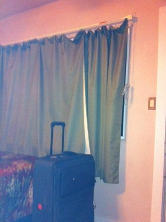 "Lions Inn Motel: The ""drapes"" that wouldnt close and lay right on the heater (not very safe)"