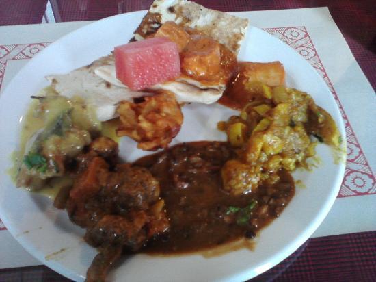 Indian Punjabi Clay Oven: watermelon, naan, butter chicken, mushrooms, zucchini