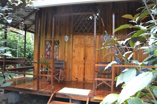 Coral Hill Bungalows: the view of the Colibri room from outside the perfect garden