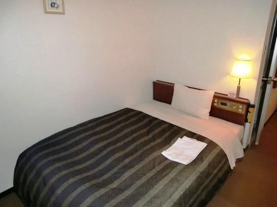 Hotel Ascent Hamamatsu: 室内 ベッド付近