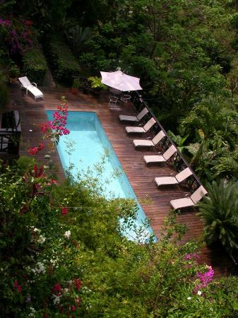 view of pool & garden from top balcony