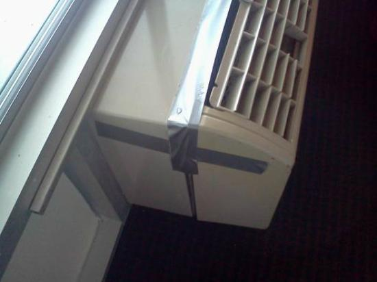 Rodeway Inn: A/C unit held together with duct tape
