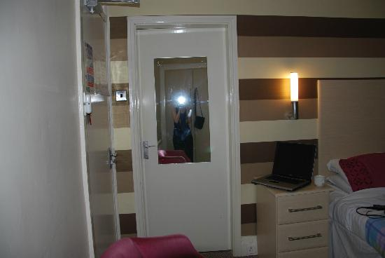 The Boston Hotel: our double room also had a single room attached through the mirror door,