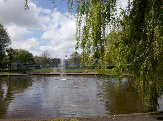Victoria Park: Pond with fountain, skate park in the background.