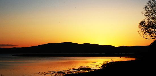 The Red Door Country House: The view at sunset over Lough Swilly from the gardens of the Red Door