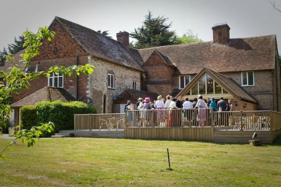 Howfield Manor Hotel: Rear of Manor with decked patio and large open room.