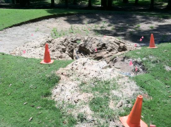 Lake Blackshear Resort Golf Club: Bunker under repair. Judging by the foot tall weeds, no one has attempted to repair this mess in