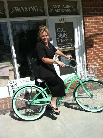 OC Skin Secrets Day Spa: Angela Imperato, Owner riding a bike in Toluca Lake, CA