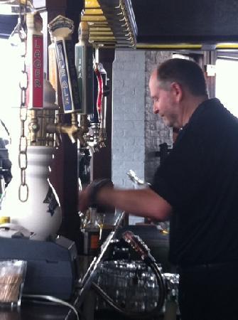 PIER 73 Restaurant: hard working bartender