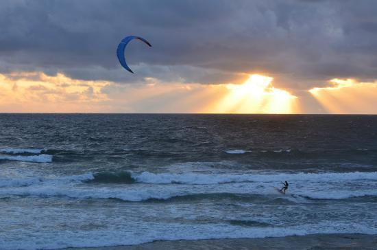 Surfer Beach Hotel: Kite surfer in the sunset from our balcony.