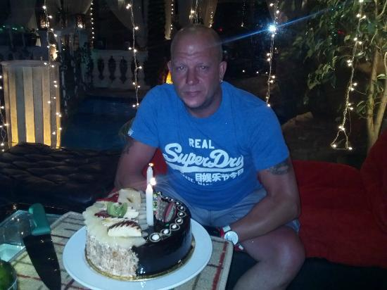The Genesis Pub and Restaurant: Nick and his cake