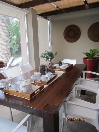 Manor 38: breakfast table overlooking the pool and opened up for tea time