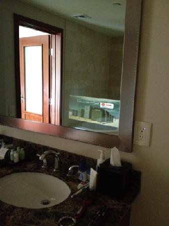 Viana Hotel & Spa, BW Premier Collection: tv in the mirror in the bathroom. So different and fun