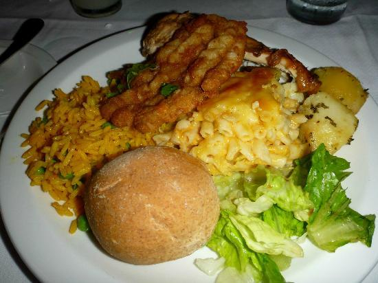 Bajan Roots and Rhythms: Fried Flying Fish, Chicken, Macaroni Pie, Salad, Rice, Potatoes.  Lots of delicious Caribbean fo