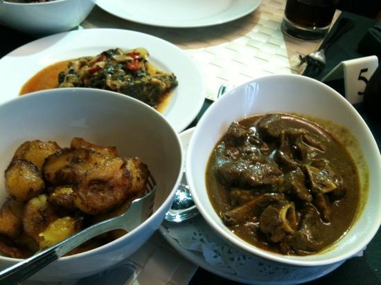 O-Tower Caribbean Cuisine: plantin, salt fish in calaloo, curry goat.