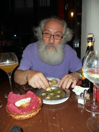 Brasserie Au Bon Plaisir: Moncef enjoying his escargot!