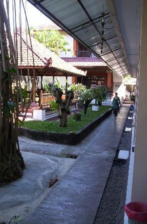 Jesen's Inn II : Lovely manager Desak walking down the courtyard.
