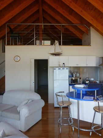 Snug Cove Villas: living/dining/kitchen area with mezzanine loft above