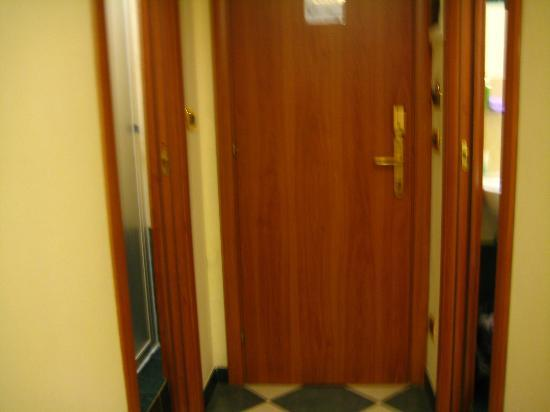 Hotel Giorgina: Entrance door middle, left Toilet door, right shower door