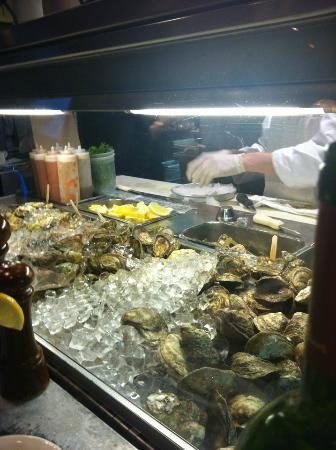 Blue Point Grill: From the counter, we watched oyster preparation.