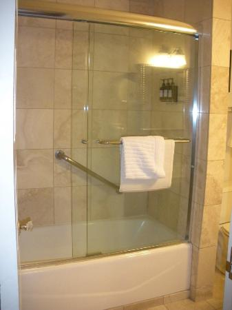 Cypress Inn: Room 235 bath/shower combo, travertine marble/glass