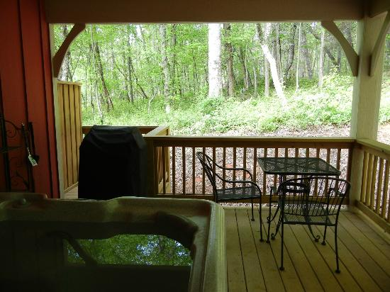 Asheville Cottages: porch with hot tub, table, and gas grill