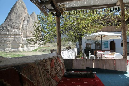 Ufuk Pension: view from outdoor lounge with cushions and table