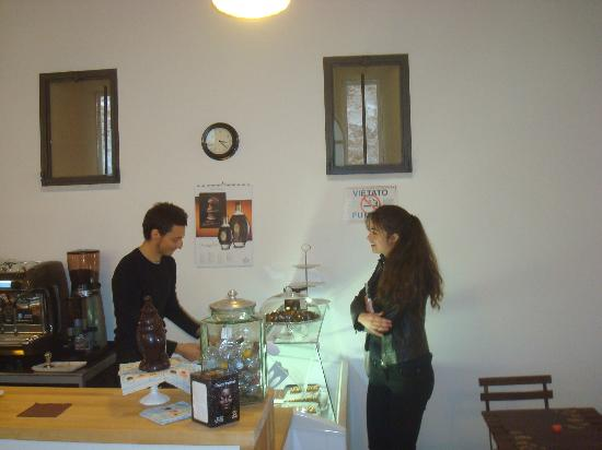 Cioccolateria Lorenzo: The owner of the store sells chocolate to a pretty girl.