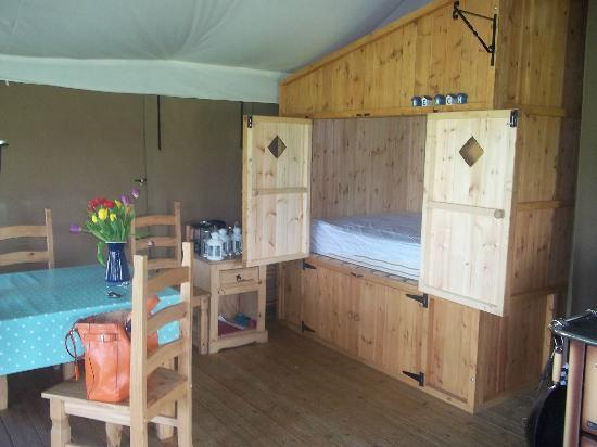 The Hideaway - Wild Luxury: Bed in the cupboard & dining area.