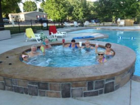 Happy Hollow Resort: friends in hot tub, with owners