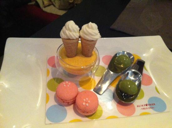 Au 14 Fevrier Vieux Lyon: After dessert: mini cones to dip in limencello sugar, green tea panna cotta, black Japanese suga