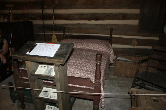 Historic Ogle Log Cabin : Old timey bed inside the Ogle Log Cabin. Also a guest book for your name & town your from.