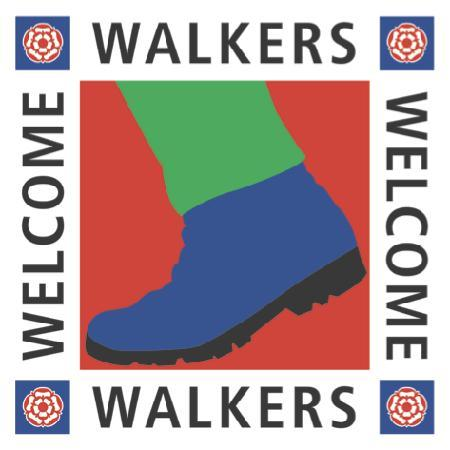 The Metropolitan : walkers logo